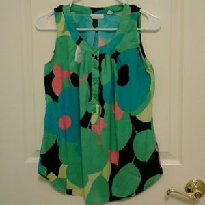 A lady's top in good condition size XS